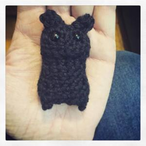 Small black crocheted bat without wings